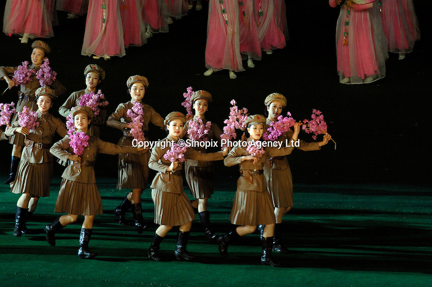 """The Arirang Games in PyongYang, North Korea. Over 100,000 perform. The Mass Games are government-organized events glorifying its two leaders of the DPRK (Democratic People's Republic of Korea) """"Dear Leader"""", Kim Jong-il and his father the """"Great Leader"""" Kim II-Sung."""