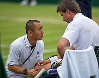 London, England, 28 june, 2016, Tennis, Wimbledon, Igor Sijsling (NED) falls and injured himself and is treated by a fysio<br /> Photo: Henk Koster/tennisimages.com