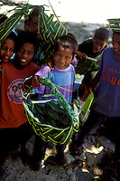 Young native boys in Yap display ti leaf handicrafts in Yap, Micronesia.