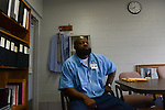 Marcus Wiggins, who was beaten and electrotortured by several Chicago Police detectives working under Commander Jon Burge at Area 3 in September 1991, sits in an administrative office of the Robinson Correctional Center in Robinson, Illinois on August 10, 2016.  Wiggins received a $95,000 settlement which did not end his troubles as the same group of officers sought to pin two more murder cases on him, the first having been when he was tortured age 13, the second was thrown out of court by  the judge who called the case flimsy and the third attempt of the same group of officers was successful when the case landed in front of Judge Dennis Dernbach, a former Assistant State's Attorney who worked on Area 2 cases when Burge was Commander there.