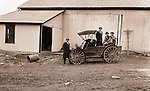 Eastern Ohio:  Brady and Sarah Mathews Stewart and members of Mathews family posing next to the International Harvester Auto Wagon.