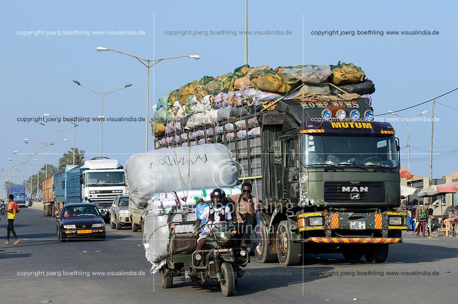 TOGO, Lome, Boulevard du Mono, frontier station to Ghana, truck and chinese Apsonic three-wheeler transport goods to border of Ghana / Warentransport zum Grenzuebergang zu Ghana