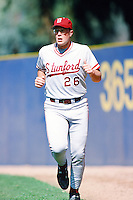 Kyle Peterson of the Stanford Cardinal runs in the outfield before a 1996 NCAA baseball season game against the UCLA Bruins at Jackie Robinson Stadium in Los Angeles, California. (Larry Goren/Four Seam Images)