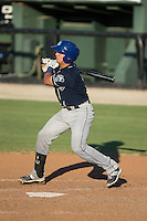 Dom Nunez (9) of the Asheville Tourists follows through on his swing against the Kannapolis Intimidators at Intimidators Stadium on June 28, 2015 in Kannapolis, North Carolina.  The Tourists defeated the Intimidators 6-4.  (Brian Westerholt/Four Seam Images)