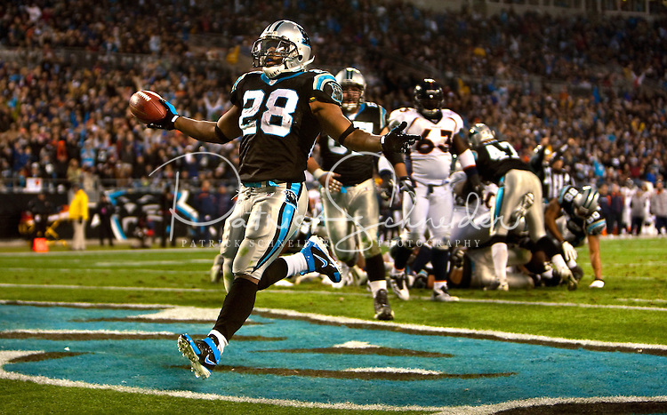 Carolina Panthers running back Jonathan Stewart (28) score a touchdown against the Denver Broncos during an NFL football game at Bank of America Stadium in Charlotte, NC.