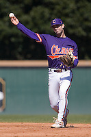 Second baseman J.D. Burgess (1) of the Clemson Tigers warms up between innings versus the Wake Forest Demon Deacons during the first game of a double header at Gene Hooks Stadium in Winston-Salem, NC, Sunday, March 9, 2008.