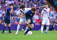August 10, 2012..Japan's Yuki Otsu is defended by South Korean defender during bronze medal match at the Millennium Stadium on day fourteen in Cardiff, England. Korea defeat Japan 2-0 to win Olympic bronze medal in men's soccer. ..