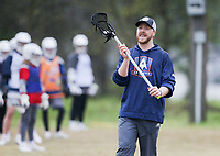 Professional lacrosse player, Tom Schreiber, gives instructions on technique, Friday, April 16, 2021 during a lacrosse clinic at Phillip's Park in Bentonville. Lacrosse is a rapidly growing sport in Northwest Arkansas. The Ozark Mountain Lacrosse program held a clinic for players in grades 7-12. Check out nwaonline.com/210417Daily/ for today's photo gallery. <br /> (NWA Democrat-Gazette/Charlie Kaijo)