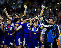Homare Sawa, trophy, Japanese team, Norio Sasaki.  Japan won the FIFA Women's World Cup on penalty kicks after tying the United States, 2-2, in extra time at FIFA Women's World Cup Stadium in Frankfurt Germany.