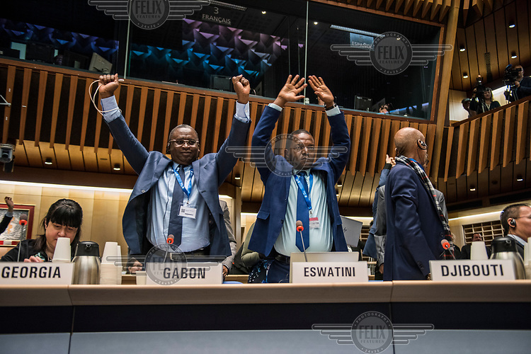 Country representatives taking part in stretching exercises during a brief pause in the opening session of the Executive Board Meeting of the World Health Organisation, the UN's health body, at the organisation's headquarters in Geneva. The annual event is taking place in the shadow of the Corona virus outbreak, which the WHO has declared as global health emergency.