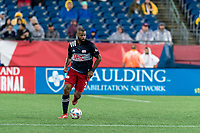 FOXBOROUGH, MA - AUGUST 4: Andrew Farrell #2 of New England Revolution brings the ball forward during a game between Nashville SC and New England Revolution at Gillette Stadium on August 4, 2021 in Foxborough, Massachusetts.