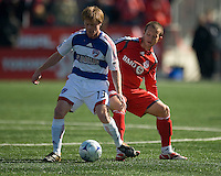 11 April 2009: Toronto FC forward Chad Barrett # 19 and FC Dallas midfielder Dax McCarty #13 during MLS action at BMO Field Toronto in a game between FC Dallas and Toronto FC. .Final score was a 1-1 draw.