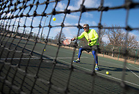 Ben Catterlin of Greenland hits a pickleball while practicing at Walker Park in Fayetteville Monday Jan. 11, 2021. Catterlin uses a device called a Lobster to launch balls for him to hit while practicing alone, usually hitting between 500-900 ball in a session.  He has played pickleball for nearly two years and plays four times a week when the weather is nice. Visit nwaonline.com/210112Daily/ and nwadg.com/photos. (NWA Democrat-Gazette/J.T. Wampler