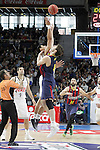 Real Madrid's Gustavo Ayon (l) and FC Barcelona's Ante Tomic during Liga Endesa ACB match.Apri 12,2015. (ALTERPHOTOS/Acero)