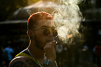 New York - NEW YORK - APRIL 20: A man smokes a marijuana cigarette during 4/20 celebrations on April 20, 2021 in New York. 4/20 is the day where tens of thousands of Americans gather around the country to celebrate a drug that remains illegal in some states of the U.S. (Photo by John Smith/VIEWpress)