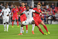 WASHINGTON, D.C. - OCTOBER 11: Josh Sargent #19 of the United States and Karel Espino #14 of Cuba battle for the ball during a Nations League game between the USA and Cuba at Audi Field, on October 11, 2019 in Washington D.C.