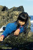 ON03-006z  Ocean - girl exploring tidepool on rocky beach - Acadia National Park, Maine