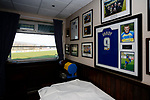 Team pictures and a Jamie Vardy shirt in the Directors Lounge at the Look Local Stadium. Stocksbridge Park Steels v Pickering Town, Evo-Stik East Division, 17th November 2018. Stocksbridge Park Steels were born from the works team of the local British Steel plant that dominates the town north of Sheffield.<br /> Having missed out on promotion via the play offs in the previous season, Stocksbridge were hovering above the relegation zone in Northern Premier League Division One East, as they lost 0-2 to Pickering Town. Stocksbridge finished the season in 13th place.