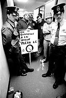 April 6, 1977 File Photo - Montreal, Quebec  (original caption) : Une cinquantaine de membres de la CSN-Construction on occupe les bureaux du Ministre du Travail, M Jacques Couture a qui l'on reproche de faire perdre de l'argent aux travailleurs en retardant la publication du decret de la construction. (Photo : Alain Renaud)