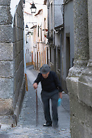 a narrow street a man walking evora alentejo portugal