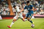 James Rodriguez (l) of Real Madrid battles for the ball with Facundo Roncaglia of RC Celta de Vigo during their La Liga match at the Santiago Bernabeu Stadium between Real Madrid and RC Celta de Vigo on 27 August 2016 in Madrid, Spain. Photo by Diego Gonzalez Souto / Power Sport Images