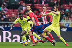 Diego Costa (C) of Atletico de Madrid fights for the ball with Amath Ndiaye Diedhiou (L) and Sergio Mora Sanchez of Getafe CF during the La Liga 2017-18 match between Atletico de Madrid and Getafe CF at Wanda Metropolitano on January 06 2018 in Madrid, Spain. Photo by Diego Gonzalez / Power Sport Images