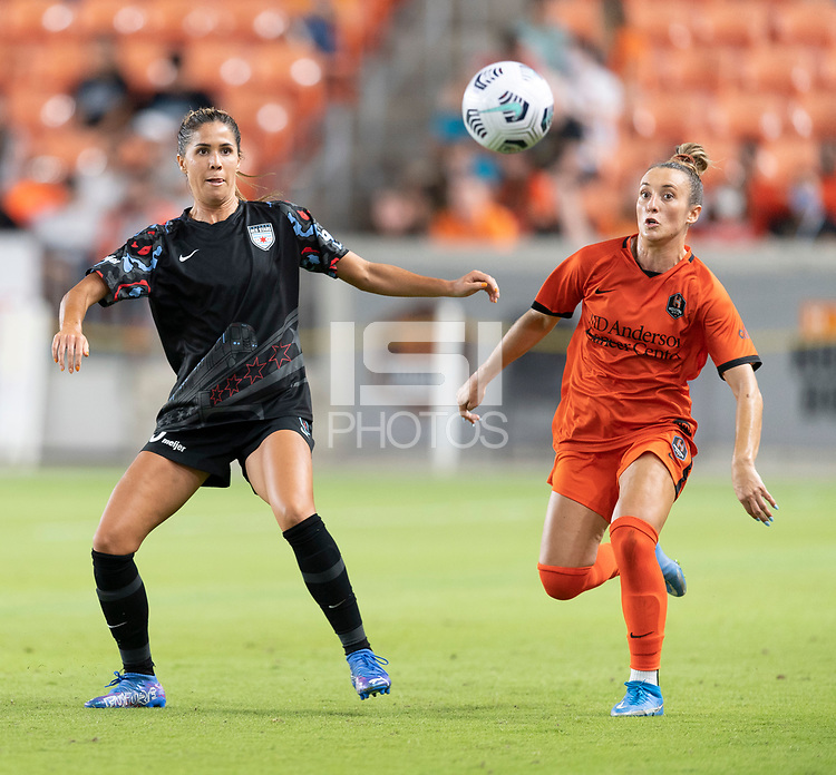 HOUSTON, TX - SEPTEMBER 10: Katie Johnson #33 of the Chicago Red Stars and Gabby Seiler #5 of the Houston Dash chase after a loose ball during a game between Chicago Red Stars and Houston Dash at BBVA Stadium on September 10, 2021 in Houston, Texas.
