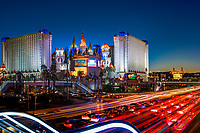 Colorful twilight on the Excalibur Casino, with traffic light trails on The Strip and stair lift's neon lights in the foreground in Las Vegas Nevada