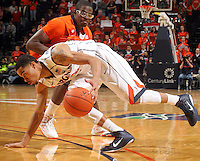 Feb. 2, 2011; Charlottesville, VA, USA;  Virginia Cavaliers guard Mustapha Farrakhan (2) drives past Clemson Tigers forward Bryan Narcisse (21) during the game at the John Paul Jones Arena. Virginia won 49-47. Mandatory Credit: Andrew Shurtleff