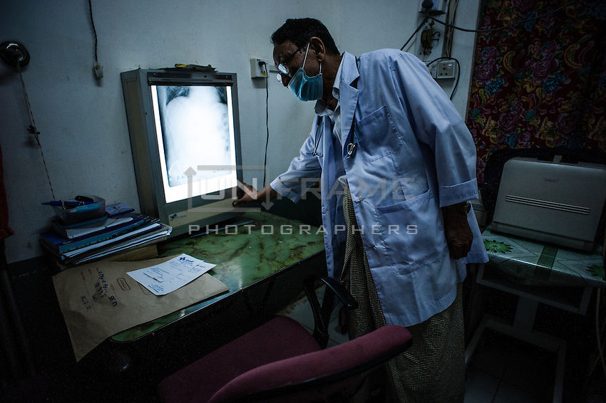 A doctor monitors a patient x-ray scan