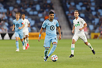 SAINT PAUL, MN - MAY 1: Emanuel Reynoso #10 of Minnesota United FC with the ball during a game between Austin FC and Minnesota United FC at Allianz Field on May 1, 2021 in Saint Paul, Minnesota.