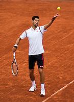 Paris, France, 31 June, 2016, Tennis, Roland Garros, Novak Djokovic (SRB) serves the ball <br /> Photo: Henk Koster/tennisimages.com