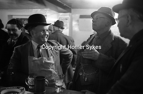 Ale tasting. The Court Leet of the Manor of Wareham in Dorset, is one of the few surviving Court Leets. And is the remains of a once powerful feudal court system. <br /> <br /> Mr Eddie Anderson, Ale Taster. Mr Herbie Elmes, the Bailiff of Court Leet, (who is drinking from a pewter mug  dated from the Great Fire of Wareham 1762.) Mr Cecil Mears, Ale Taster. Info thanks to  Suzanne Elmes.<br /> <br /> My ref 7a/844/1974