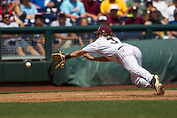 Mississippi State third baseman Alex Detz (3) dives toward a hard ground ball during Game 11 of the 2013 Men's College World Series against the Oregon State Beavers on June 21, 2013 at TD Ameritrade Park in Omaha, Nebraska. The Bulldogs defeated the Beavers 4-1, to reach the CWS Final and eliminating Oregon State from the tournament. (Andrew Woolley/Four Seam Images)