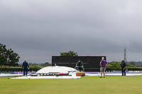 The ground staff hard at work clearing up from the rain before  Middlesex vs Hampshire Hawks, Royal London One-Day Cup Cricket at Radlett Cricket Club on 30th July 2021