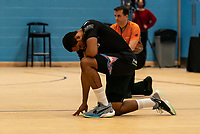 Lacey James of Surrey Scorchers  takes a knee prior to the tip off during the BBL Championship match between Surrey Scorchers and Newcastle Eagles at Surrey Sports Park, Guildford, England on 20 March 2021. Photo by Liam McAvoy.