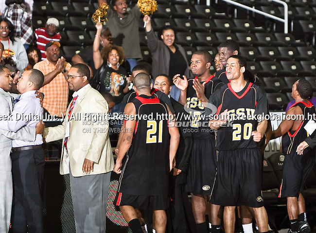 The Grambling State Tigers celebrate after winning the SWAC Tournament game between the Grambling State Tigers and the Mississippi Valley State Delta Devils at the Special Events Center in Garland, Texas. Grambling State defeats Mississippi Valley 65 to 62