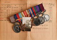 BNPS.co.uk (01202) 558833<br /> Pic: ZacharyCulpin/BNPS<br /> <br /> Pictured: Ken's Bomber command clasp 75 (second left) pictured on top of his flight log. Former Squadron Leader Ken Symonds on board a Lancaster Bomber in 1945<br /> <br /> An RAF veteran who flew the last Lancaster bomber home on the final sortie of the war has finally received his Bomber Command clasp 75 years later.<br /> <br /> Former Squadron Leader Ken Symonds, 97, limped his aircraft back to Britain following the last big raid of Bomber Command's Europe offensive.<br /> <br /> The sortie took place over Berchestgaden, the town in the Bavarian Alps where Adolf Hitler had his Eagles Nest retreat, on April 25, 1945 - five day's before the evil dictator's suicide.<br /> <br /> The Lancaster was struck by anti-aircraft fire which resulted in one of its four engines to be knocked out.
