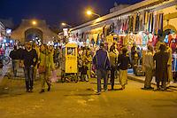 Essaouira, Morocco.  Evening Street Scene, Ave. Mohamed Zerktouni.  Pop Corn Vendor in Center.