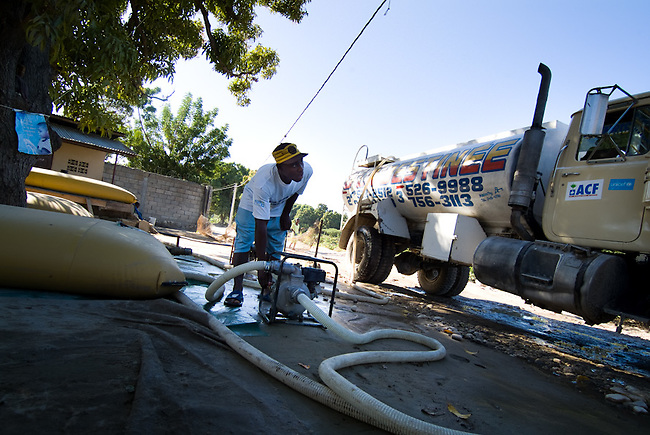 Water pumping and cleaning station at the river mapou close to Gonaives. International ngo ACF(Action contre la faime) supported by UNICEF Haiti brings fresh water to 28 sites in Gonaives where since Hurrican Ike has collapsed the water system.