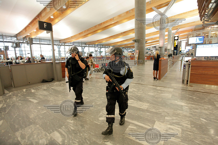 (July22,2011) Armed police at Gardermoen Airport north of Oslo after a large vehicle bomb was detonated near the offices of Norwegian Prime Minister Jens Stoltenberg on 22 July 2011. Although Stoltenberg was reportedly unharmed the blast resulted in several injuries and deaths. <br />
