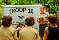 Boy Scouts attending Boy Scout resident camp at Camp Raven Knob in summer 2010 lead a ceremony. (Shaving - or partially shaving heads -- is a camp tradition). Camp Raven Knob Scout Reservation, one of the largest Boy Scout camps in the United States, is located within Boy Scouts of America's Old Hickory Council in Mt. Airy, North Carolina. Troops from across the US attend the camp's one-week residential boys' summer programs, which offer instruction on more than 40 merit badges, adventure programs and new Scout orientation.