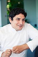 Mauro Colagreco, chef of restaurant Mirazur, talks at the bar, Menton, France, 18 September 2013