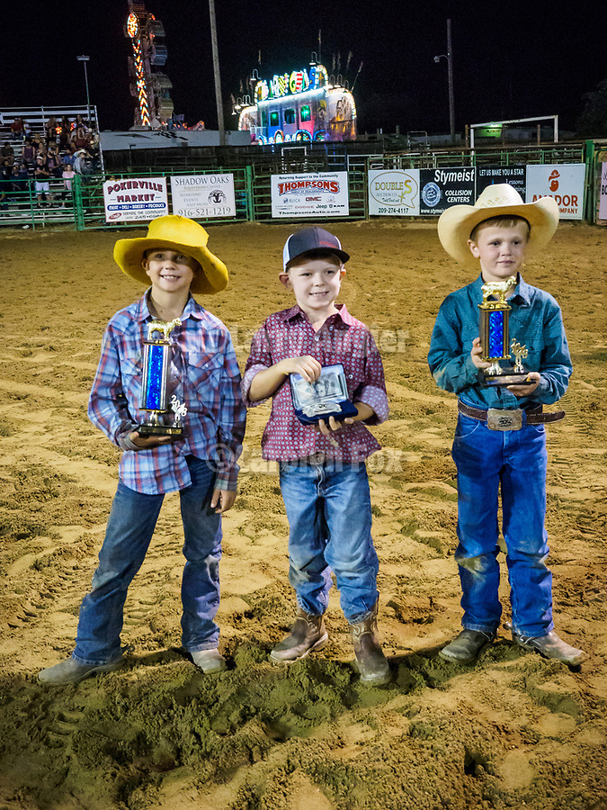Winners of the Mutton Bustin' finals during the rodeo, Saturday night at the 80th Amador County Fair, Plymouth, Calif.<br /> .<br /> .<br /> .<br /> .<br /> #AmadorCountyFair, #1SmallCountyFair, #PlymouthCalifornia, #TourAmador, #VisitAmador