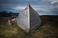 Overturned boat on grass, Ludag, South Uist, Western Isles, Scotland