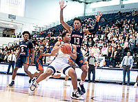 WASHINGTON, DC - NOVEMBER 16: Troy Baxter #13 of Morgan State defends against Justin Williams #4 of George Washington during a game between Morgan State University and George Washington University at The Smith Center on November 16, 2019 in Washington, DC.