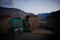 An Afghan National Army (ANA) soldier from Turkan Company, 2nd Brigade prays on his guard post at Forward Operating Base (FOB) Blessing in the Pesh Valley.