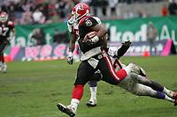 Shane Boyd (Quarterback COlogne Centurions) verfolgt von Jared Newberry und Travis Harris (beide Linebacker Frankfurt Galaxy)
