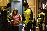 Pictured: A woman is spoken to by two police officers in Swansea. Tuesday 31 December 2019 to Wednesday 01 January 2020<br /> Re: Revellers on a night out for New Year's Eve in Wind Street, Swansea, Wales, UK.