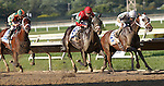 September 1, 2014: Protonico (#8, red cap), Joe Bravo up, passes frontrunner Classic Giacnroll (Kendrick Carmouche up), on his way to winning the grade 3 Smarty Jones Stakes at Parx Racing in Bensalem, PA. Trainer is Todd Pletcher. Owner is International Equities Holding, Inc. Albano, left, with Kerwin Clark, finished third. ©Joan Fairman Kanes/ESW/CSM